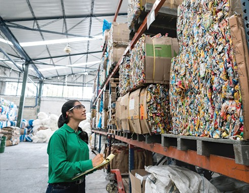 woman working in recycling facility